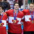 Corey Perry Jamie Benn Photos - Gold medalists John Tavares #20, Jamie Benn #22 and Corey Perry #24 of Canada celebrate during the medal ceremony after defeating Sweden 3-0 during the Men's Ice Hockey Gold Medal match on Day 16 of the 2014 Sochi Winter Olympics at Bolshoy Ice Dome on February 23, 2014 in Sochi, Russia. - Ice Hockey - Winter Olympics Day 16