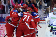 Ilya Kovalchuk #71 of Russia celebrates scoring a goal in the second period with Alexander Ovechkin #8 and Andrej Markov #79 against Slovenia during the Men's Ice Hockey Preliminary Round Group A game on day six of the Sochi 2014 Winter Olympics at Bolshoy Ice Dome on February 13, 2014 in Sochi, Russia.