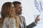 Karen Martinez (L) and Juanes attend The Inaugural $12 Million Pegasus World Cup Invitational, The World's Richest Thoroughbred Horse Race At Gulfstream Park at Gulfstream Park on January 28, 2017 in Hallandale, Florida.