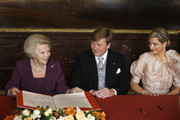 Queen Beatrix of the Netherlands signs the Act of Abdication as her son Prince Willem-Alexander of the Netherlands and his wife Princess Maxima of the Netherlands (R) watches during a ceremony in the Moseszaal at the Royal Palace on April 30, 2013 in Amsterdam. Queen Beatrix of the Netherlands is abdicating the throne after a 33 year reign and hands the throne to her son Prince Willem-Alexander who will be sworn in later at the Nieuwe Kerk ahead of a joint session of parliament.