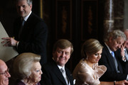 Prince Willem-Alexander of the Netherlands sits alongside his wife Princess Maxima of the Netherlands (2nd-R) during the abdication ceremony of his mother Queen Beatrix of the Netherlands (2nd-L) in the Moseszaal at the Royal Palace on April 30, 2013 in Amsterdam. Queen Beatrix of the Netherlands is abdicating the throne after a 33 year reign and hands the throne to her son Prince Willem-Alexander who will be sworn in later at the Nieuwe Kerk ahead of a joint session of parliament.