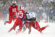Frank Gore #23 of the Indianapolis Colts is tackled by Micah Hyde #23 of the Buffalo Bills and Matt Milano #58 of the Buffalo Bills during the fourth quarter on December 10, 2017 at New Era Field in Orchard Park, New York.