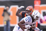 T.Y. Hilton #13 of the Indianapolis Colts runs the football upfield against Adam Jones #24 of the Cincinnati Bengals during their game at Paul Brown Stadium on October 29, 2017 in Cincinnati, Ohio.  The Bengals defeated the Colts 24-23.