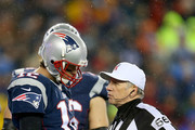 Tom Brady #12 of the New England Patriots talks with referee Walt Anderson #66 during the 2015 AFC Championship Game against the Indianapolis Colts at Gillette Stadium on January 18, 2015 in Foxboro, Massachusetts.