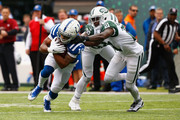 Wide receiver Marcus Johnson #16 of the Indianapolis Colts runs the all against cornerback Morris Claiborne #21 of the New York Jets during the first quarter at MetLife Stadium on October 14, 2018 in East Rutherford, New Jersey.