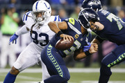 Quarterback Russell Wilson #3 of the Seattle Seahawks rushes past Jabaal Sheard #93 of the Indianapolis Colts in the fourth quarter of the game at CenturyLink Field on October 1, 2017 in Seattle, Washington.