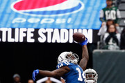 Wide receiver Zach Pascal #14 of the Indianapolis Colts goes up for a catch against cornerback Morris Claiborne #21 of the New York Jets during the second half at MetLife Stadium on October 14, 2018 in East Rutherford, New Jersey.  The New York Jets won 42-34.