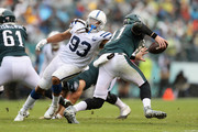 Quarterback Carson Wentz #11 of the Philadelphia Eagles avoids a tackle by defensive end Jabaal Sheard #93 of the Indianapolis Colts during the second quarter at Lincoln Financial Field on September 23, 2018 in Philadelphia, Pennsylvania.