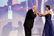 President of Venezia Classici Giuliano Montaldo and Festival hostess and actress Luisa Ranieri appear on stage during the opening ceremony at the 71st Venice Film Festival on August 27, 2014 in Venice, Italy.