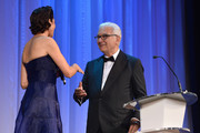 President of the Festival Paolo Baratta speaks to Festival hostess and actress Luisa Ranieri during the opening ceremony at the 71st Venice Film Festival on August 27, 2014 in Venice, Italy.