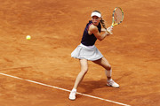 Caroline Wozniacki of Denmark hits a backhand during her first round match against Danielle Collins of the USA during day three of the International BNL d'Italia at Foro Italico on May 14, 2019 in Rome, Italy.