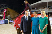 (L to R) Prince Albert II of Monaco, Charlotte Casiraghi and Katie Danby give the first prize to Hassan Bassem Mohammed during the Longines Grand Prix du Prince during the International Monte-Carlo Jumping at Port Hercule on June 28, 2014 in Monaco, Monaco.