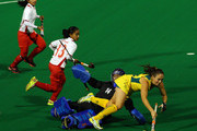Hope Munro of Australia is challenged by Farah Ayuni Yahya of Malaysia during the match between Australia and Malaysia on day one of the International Superseries at Perth Hockey Stadium on October 20, 2011 in Perth, Australia.