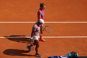 Yulia Putintseva of Kazakhstan interacts with Simona Halep of Romania after Yulia Putintseva retired from their quarter-final match during day six of the Internazionali BNL d'Italia at Foro Italico on September 19, 2020 in Rome, Italy.