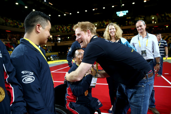 Prince Harry congratulates members of the gold medal winning Great Britain team after they win the Sitting Volleyball final match between Great Britain and the USA on Day Four of the Invictus Games at the Olympic Park on September 14, 2014 in London, England.