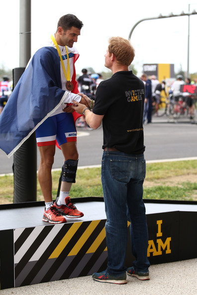Prince Harry presents a bronze medal to Henri Rebujent of France after he finishes 3rd in the Men's Circuit Race IRB2 during the Road Cycling on Day Three of the Invictus Games at the Olympic Park on September 13, 2014 in London, England.