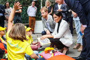 Scott Morrison, Prince Harry, Duke of SussexÊandÊMeghan, Duchess of Sussex talking with young kids during day two of the Invictus Games Sydney 2018 at Sydney Olympic Park on October 21, 2018 in Sydney, Australia.