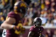 Rodney Smith #1 of Minnesota carries the ball against the Iowa during the third quarter of the game on October 8, 2016 at TCF Bank Stadium in Minneapolis, Minnesota. Iowa defeated Minnesota 14-7.