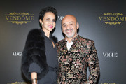 Farida Khelfa (L) and Christian Louboutin attend the Irving Penn Exhibition Private Viewing Hosted by Vogue as part of the Paris Fashion Week Womenswear Spring/Summer 2018 on October 1, 2017 in Paris, France.