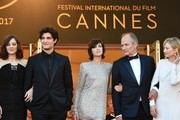 The General Delegate of the Cannes Film Festival Thierry Fremaux (L) welcomes (fromL) French actor Mathieu Amalric, French director Arnaud Desplechin, French actress Marion Cotillard, French actor Louis Garrel, French actress Charlotte Gainsbourg, French actor Hippolyte Girardot and Italian actress Alba Rohrwacher as they arrive on May 17, 2017 for the screening of their film 'Ismael's Ghosts' (Les Fantomes d'Ismael) during the opening ceremony of the 70th edition of the Cannes Film Festival in Cannes, southern France.  / AFP PHOTO / Alberto PIZZOLI