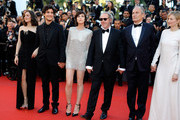 """(L-R) Marion Cotillard, Louis Garrel, Charlotte Gainsbourg, Hippolyte Girardot, director Arnaud Desplechin and Alba Rohrwacher attend the """"Ismael's Ghosts (Les Fantomes d'Ismael)"""" screening and Opening Gala during the 70th annual Cannes Film Festival at Palais des Festivals on May 17, 2017 in Cannes, France."""