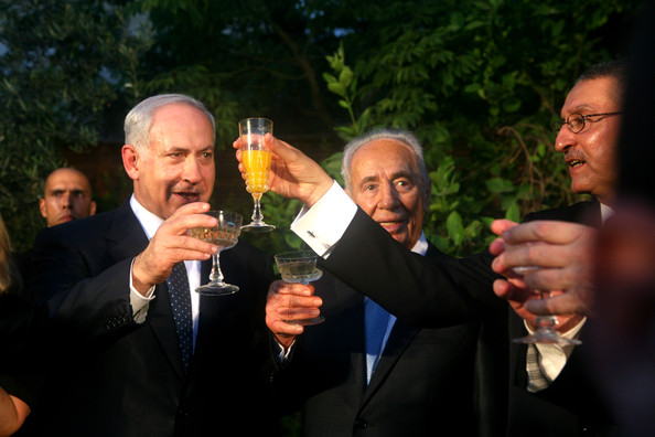 Shimon Peres Israeli  Prime Minister Benjamin Netanyahu (L) and President Shimon Peres (C) raise a toast at  Egyptian ambassador Yasser Rida's residence during the Egyptian national day celebrations, July 23, 2009 in Hertzila, Israel. According to reports Netanyahu refered during his speech to a 2002 Suadi initiative that could assist in reaching a regional peace agreement.