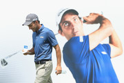 Edoardo Molinari of Italy walks past a photograph of himself on the 11th hole during the Pro Am event prior to the start of the Italian Open at Gardagolf Country Club on May 29, 2018 in Brescia, Italy.