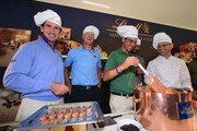 Fredrik Andersson-Hed of Sweden, Matteo Manassero of Italy and Alvaro Quiros of Spain discover how Lindt chocolates are made after the pro-am prior to the start of the Italian Open golf at Circolo Golf Torino on September 18, 2013 in Turin, Italy.
