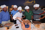 Gonzalo Fernandez Castano of Spain, Fredrik Andersson-Hed of Sweden, Matteo Manassero of Italy and Alvaro Quiros of Spain discover how Lindt chocolates are made after the pro-am prior to the start of the Italian Open golf at Circolo Golf Torino on September 18, 2013 in Turin, Italy.