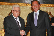 In this handout image supplied by the Palestinian President's Office (PPO), Palestinian President Mahmoud Abbas attends a meeting with the President of the Italian Parliament Gianfranco Fini, on July 17, 2012 in Rome, Italy.