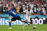 Raheem Sterling of England evades the tackle of Jorginho of Italy during the UEFA Euro 2020 Championship Final between Italy and England at Wembley Stadium on July 11, 2021 in London, England.