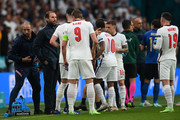 Gareth Southgate, Head Coach of England speaks with his players during the UEFA Euro 2020 Championship Final between Italy and England at Wembley Stadium on July 11, 2021 in London, England.