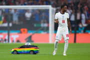 The Adidas Uniforia match ball is delivered on to the pitch by a Volkswagen Remote Control Mini Car past Raheem Sterling of England prior to the UEFA Euro 2020 Championship Final between Italy and England at Wembley Stadium on July 11, 2021 in London, England.