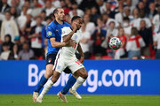 Raheem Sterling of England is challenged by Giorgio Chiellini of Italy during the UEFA Euro 2020 Championship Final between Italy and England at Wembley Stadium on July 11, 2021 in London, England.