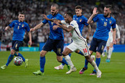Leonardo Bonucci of Italy battles for possession with Raheem Sterling of England during the UEFA Euro 2020 Championship Final between Italy and England at Wembley Stadium on July 11, 2021 in London, England.