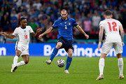 Giorgio Chiellini of Italy is watched by Raheem Sterling and Kieran Trippier of England during the UEFA Euro 2020 Championship Final between Italy and England at Wembley Stadium on July 11, 2021 in London, England.