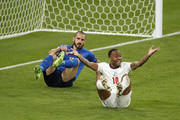 Raheem Sterling of England reacts after a challenge as Leonardo Bonucci of Italy looks on during the UEFA Euro 2020 Championship Final between Italy and England at Wembley Stadium on July 11, 2021 in London, England.
