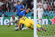 Raheem Sterling of England is challenged by Leonardo Bonucci of Italy during the UEFA Euro 2020 Championship Final between Italy and England at Wembley Stadium on July 11, 2021 in London, England.