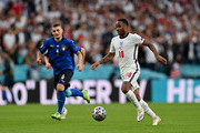 Raheem Sterling of England runs with the ball whilst under pressure from Marco Verratti of Italy during the UEFA Euro 2020 Championship Final between Italy and England at Wembley Stadium on July 11, 2021 in London, England.