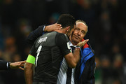 Gianluigi Buffon of Italy and Head coach Italy Gian Piero Ventura dejected at the end of the FIFA 2018 World Cup Qualifier Play-Off: Second Leg between Italy and Sweden at San Siro Stadium on November 13, 2017 in Milan, Sweden.