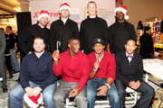 """(L-R, back row) New York Pro Athletes Matt Dodge, Bear Pascoe, Kevin Boss, Deon Grant, (L-R, front row) Shaun O'Hara, Antrel Rolle, Corey Webster and Terrell Thomas pose during JOE Joseph Abboud, JCPenney, and IAVA celebrate """"Welcome Home Joe"""" with """"Combat to Career"""" an event to benefit veterans at JCPenney on December 7, 2010 in New York City."""