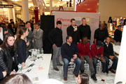 """(L-R, back row) New York Pro Athletes Matt Dodge, Bear Pascoe, Kevin Boss, Deon Grant, (L-R, front row) Shaun O'Hara, Antrel Rolle, Corey Webster and Terrell Thomas speak during JOE Joseph Abboud, JCPenney, and IAVA celebrate """"Welcome Home Joe"""" with """"Combat to Career"""" an event to benefit veterans at JCPenney on December 7, 2010 in New York City."""