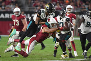 Larry Fitzgerald #11 of the Arizona Cardinals reaches for the football under pressure from Jalen Ramsey #20 of the Jacksonville Jaguars in the second half at University of Phoenix Stadium on November 26, 2017 in Glendale, Arizona. The Arizona Cardinals won 27-24.