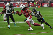 Larry Fitzgerald #11 of the Arizona Cardinals runs with the football against Jalen Ramsey #20 and Aaron Colvin #22 of the Jacksonville Jaguars in the first half at University of Phoenix Stadium on November 26, 2017 in Glendale, Arizona.
