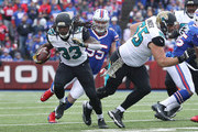 Chris Ivory #33 of the Jacksonville Jaguars carries the ball during NFL game action against the Buffalo Bills at New Era Field on November 27, 2016 in Orchard Park, New York.