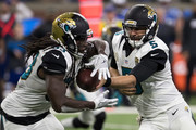 Blake Bortles #5 of the Jacksonville Jaguars hands off the football to teammate Chris Ivory #33 during an NFL game against the Detroit Lions at Ford Field on November 20, 2016 in Detroit, Michigan. The Lions defeated the Jaguars 26-19.