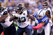 Chris Ivory #33 of the Jacksonville Jaguars runs with the ball chased by Jabaal Sheard #93 of the Indianapolis Colts during the first quarter at Lucas Oil Stadium on October 22, 2017 in Indianapolis, Indiana.