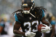 Chris Ivory #33 of the Jacksonville Jaguars runs a play before an NFL preseason game against the New York Jets at MetLife Stadium on August 11, 2016 in East Rutherford, New Jersey.