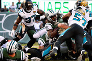 Chris Ivory #33 of the New York Jets gets across the goal line for a third quarter touchdown against the Jacksonville Jaguars at MetLife Stadium on November 8, 2015 in East Rutherford, New Jersey.