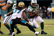 Chris Ivory #33 of the New York Jets is pursued by Johnathan Cyprien #37 of the Jacksonville Jaguars during the fourth quarter during the fourth quarter at MetLife Stadium on November 8, 2015 in East Rutherford, New Jersey. The New York Jets defeated the Jacksonville Jaguars 28-23.